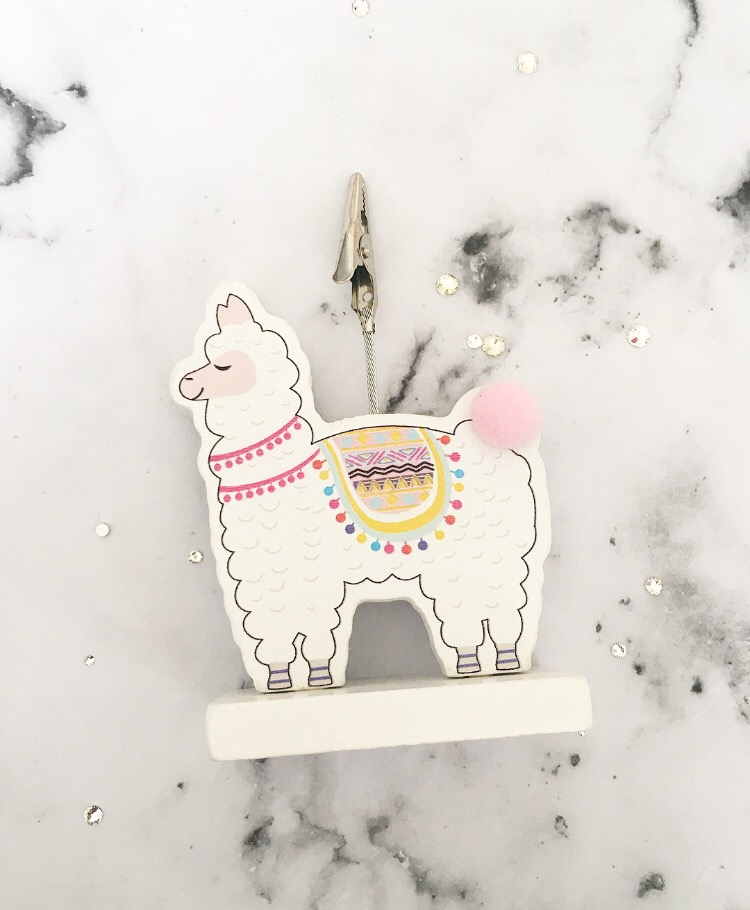 Llama photo holder with a clip at the top
