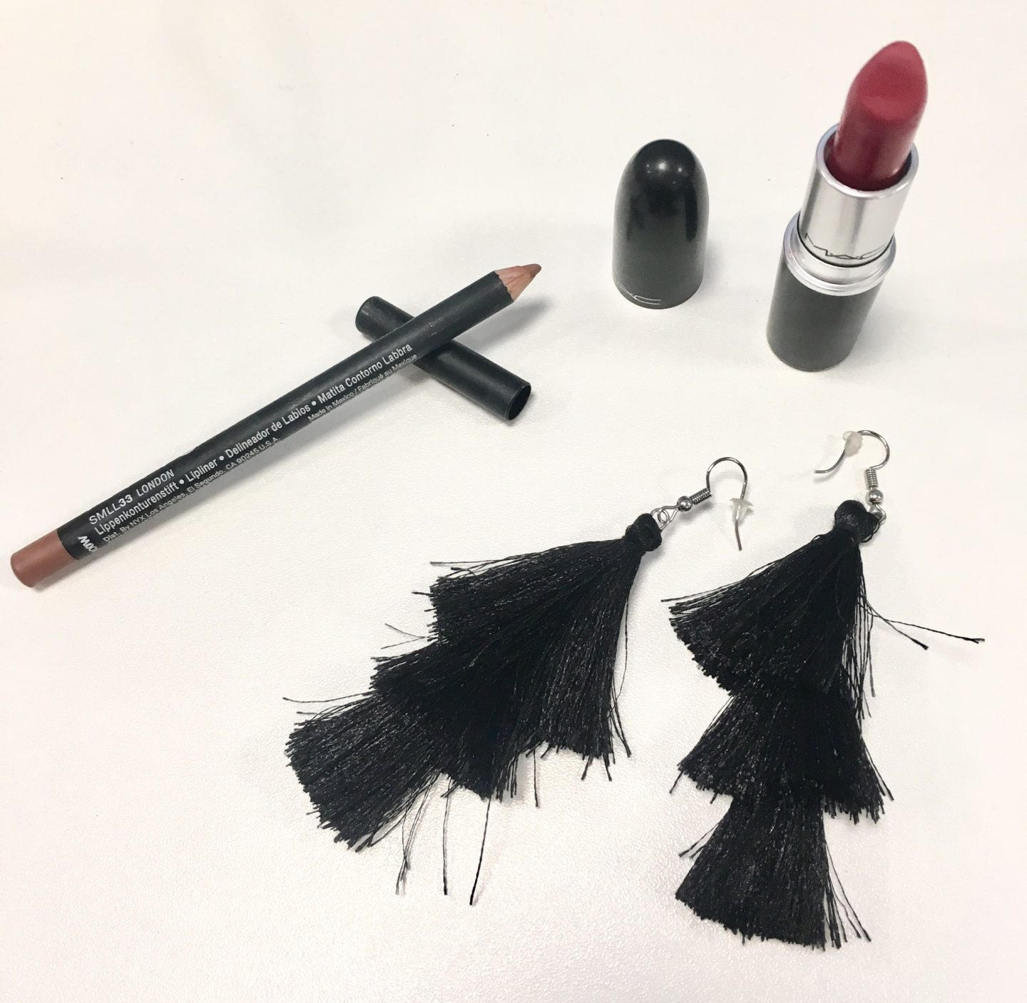 MAC ruby woo lipstick and NYX Suede Lip Liner in London